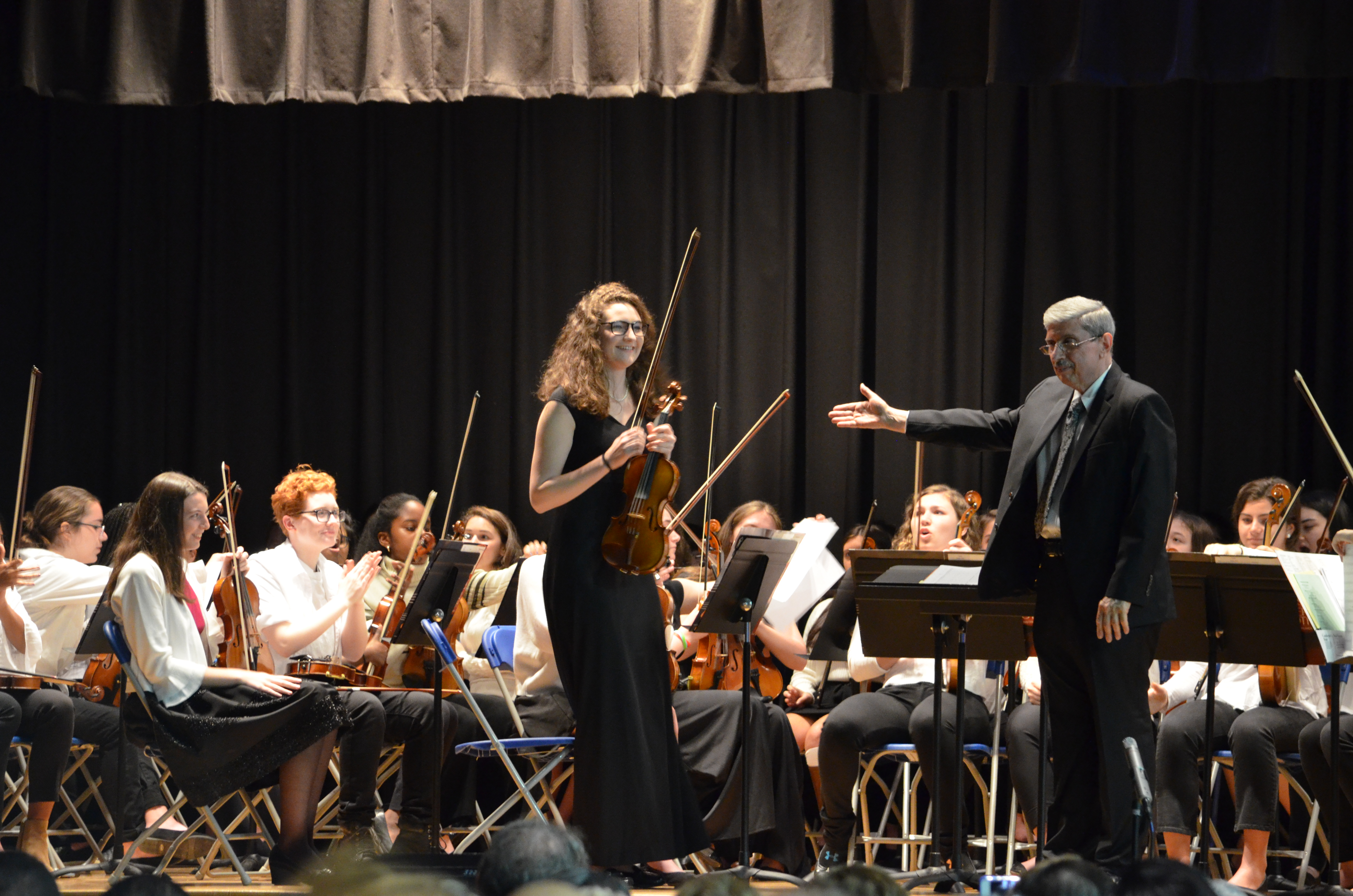 Solo by Olivia Ross, orchestra conducted by John Benza