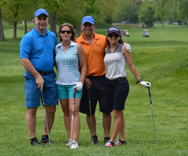 Two couples at golf